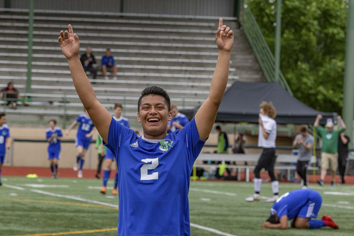 Mountain View's Carlos Cruz looks up to the crowd Saturday, seconds after the final whistle in the Thunder's 2-0 win over Kamiakin at McKenzie Stadium. Mountain View is going to the Class 3A state semifinals. Photo by Mike Schultz