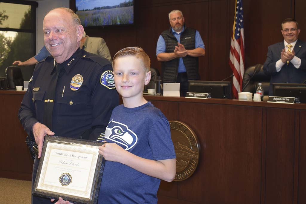 Battle Ground Police Chief Bob Richardson is shown here with Ethan Clarke, who was recently honored for his heroic actions. Photo courtesy of city of Battle Ground