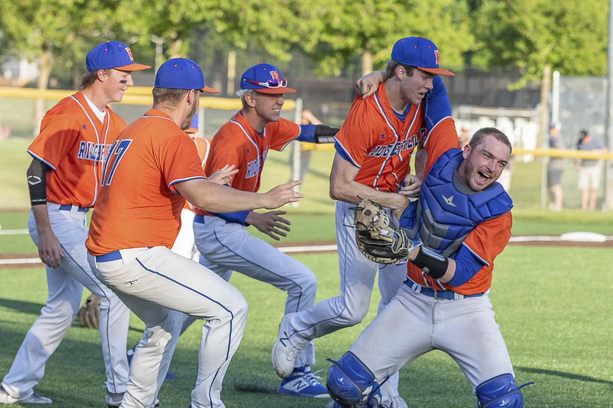 The Ridgefield Spudders celebrate after winning the Class 2A District 4 baseball title Friday with a win over league-rival Columbia River. Ridgefield and Columbia River will be playing in the state tournament this weekend. Photo by Mike Schultz