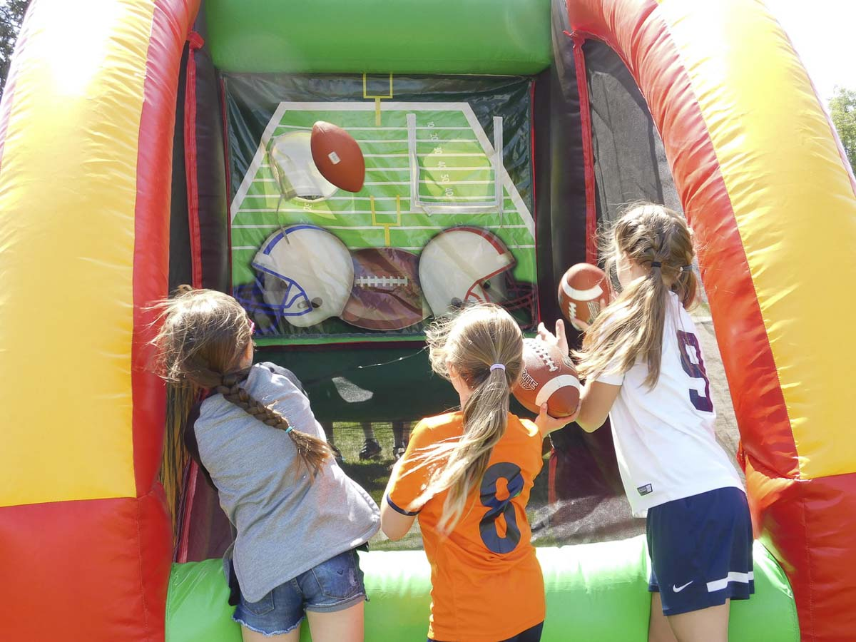 Students compete with a two-sided football pass inflatable at South Ridge Elementary School's Sport-A-Thon fundraiser. Photo courtesy of Ridgefield School District