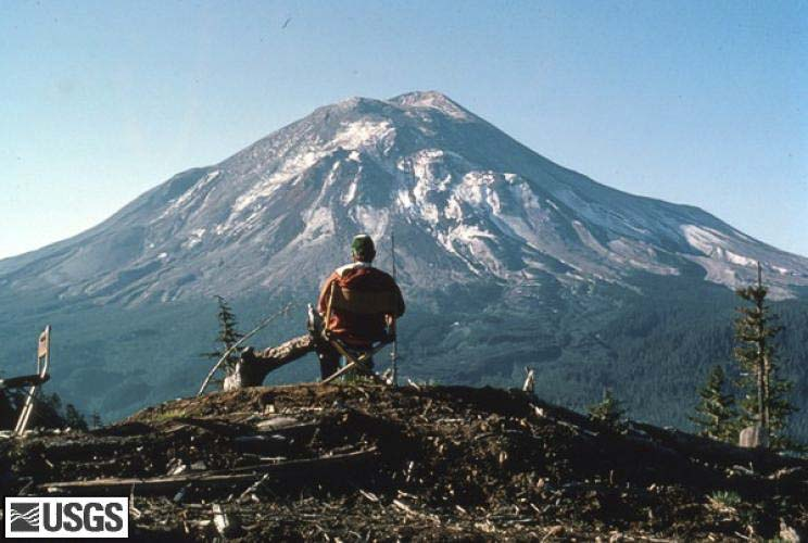 USGS geologist at Coldwater II observation post, watching Mount St. Helens. Photo courtesy of USGS