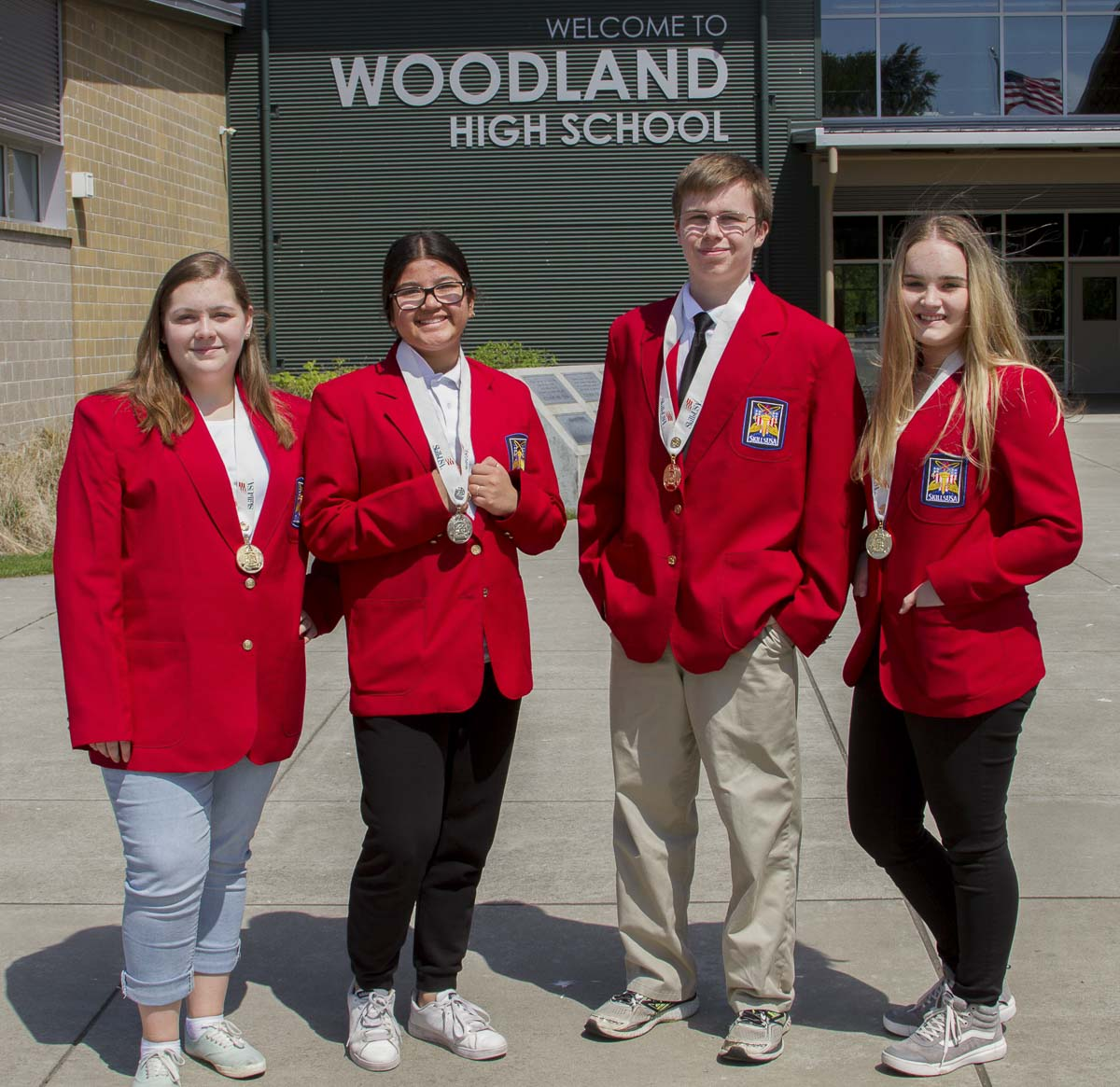 SkillsUSA team members pick from 100 specific areas of workplace expertise ranging from early childhood education and public speaking to customer service and technology literacy. Woodland High School's SkillsUSA medal winners (from left to right): Katelyn Paulson, Camila Avelar, Caleb Mouat and Brooke Schimmel. Photo courtesy of Woodland School District