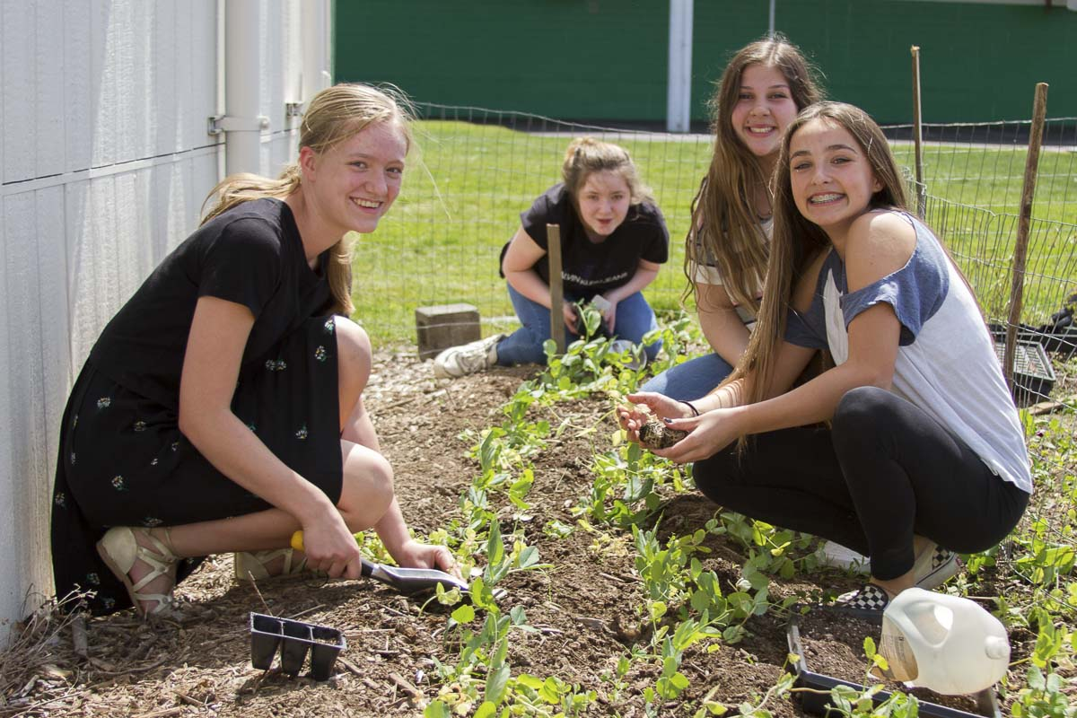 Students learn how to prepare soil and care for plants throughout the growing season. Photo courtesy of Woodland School District