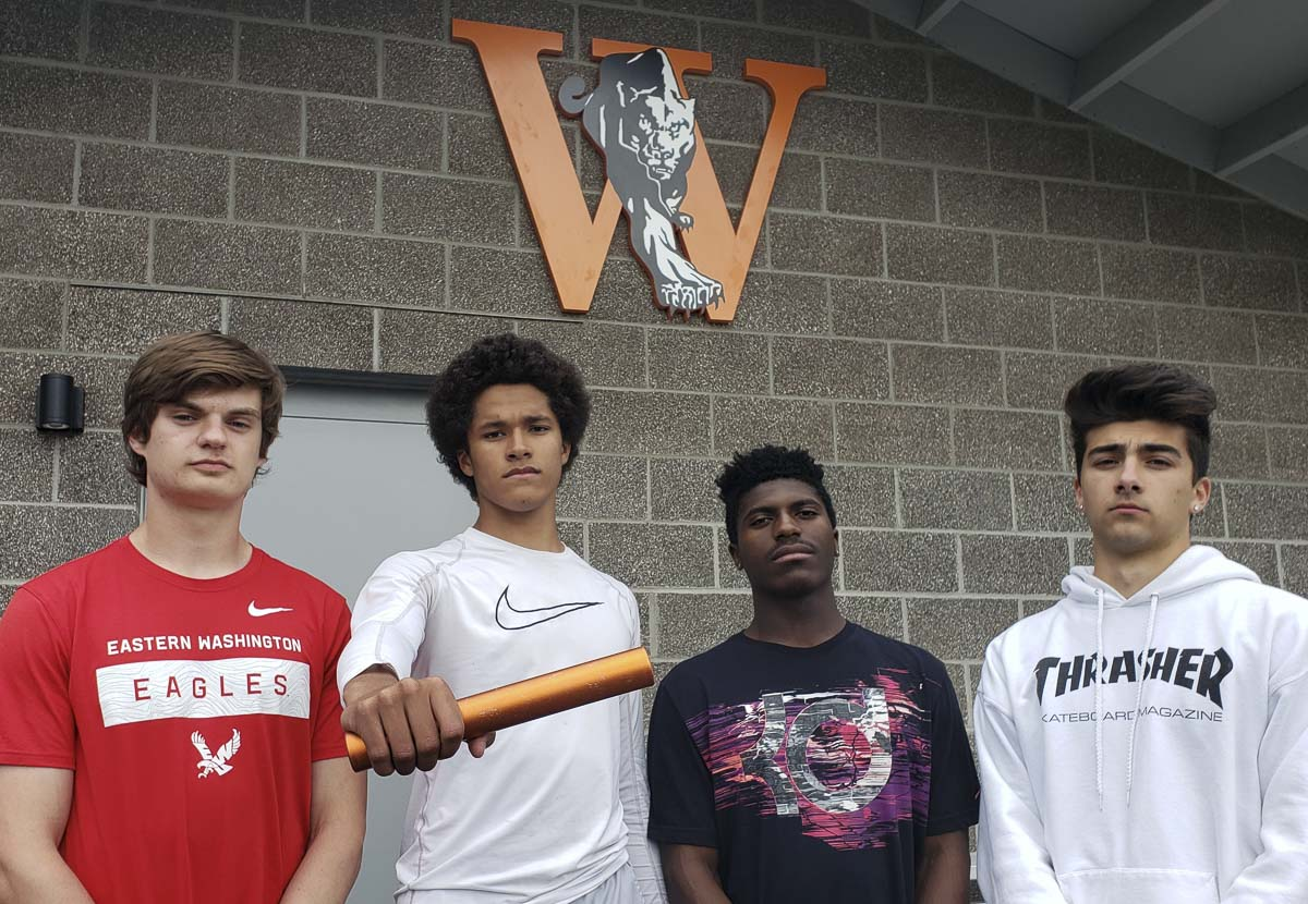 From left to right, Ryan Davy, Brig Griffin, Arcey Harton, and Kenny Kanthak — shown here in a rare moment when they are not moving fast — are hoping to bring a state title to Washougal. They have the fastest time in Class 2A Washington in the 400 relay heading into this weekend's state meet. Photo by Paul Valencia