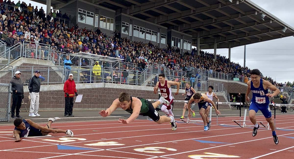 Woodland's Tyler Flanagan looks a bit like Superman as he dives for the finish line Saturday in the finals of the Class 2A 300 hurdles. Flanagan won in a photo finish. Photo courtesy of the WIAA
