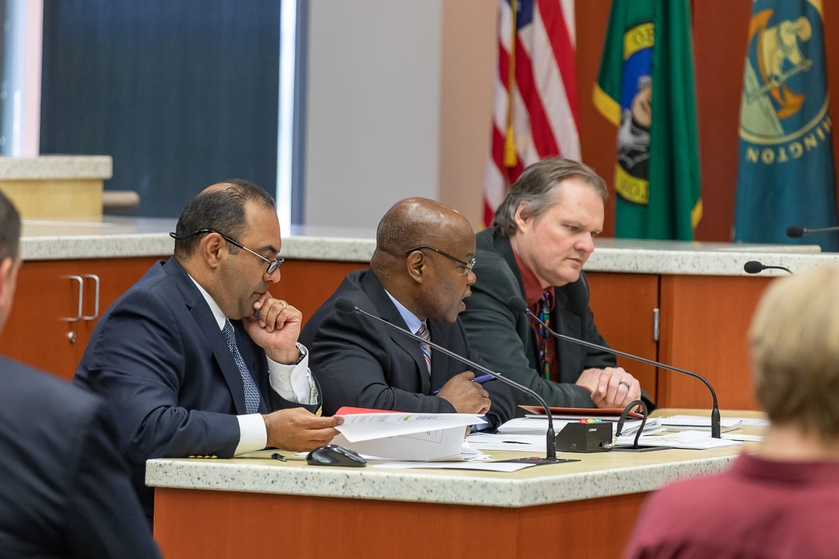 Clark County Community Planning Director Oliver Orjiako (center) talks during a work session on marijuana-related businesses. Also pictured, County Planner Jose Alvarez (left) and County Manager Shawn Henessee (right). Photo by Mike Schultz