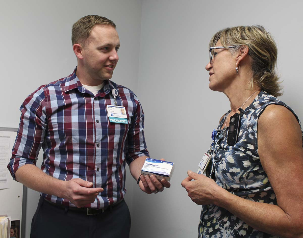 PeaceHealth Southwest Nurse Annie Neil meets with Austin Horner, the hospital's out-patient pharmacist and a key part of the Opioid Use Disorder treatment program. Photo courtesy PeaceHealth Southwest
