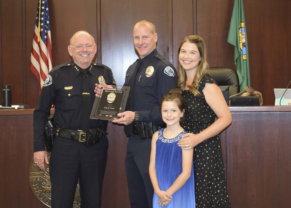 Battle Ground Police Officer Clint Fraser (middle) is shown here with his family and Battle Ground Police Chief Bob Richardson (left). Fraser was named the Battle Ground Police Department's 2018 Officer of the Year. Photo courtesy of city of Battle Ground