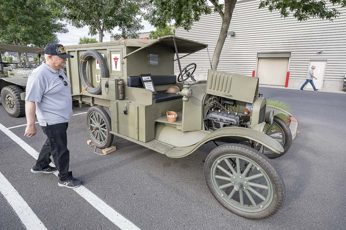 Jack Giesen takes a look at this World War I ambulance at Heroes Night on Saturday. Photo by Mike Schultz