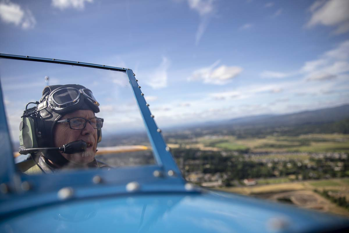 Kevin Kreiter pilots his vintage aircraft Saturday as part of Heroes Night festivities in east Vancouver. Photo by Jacob Granneman
