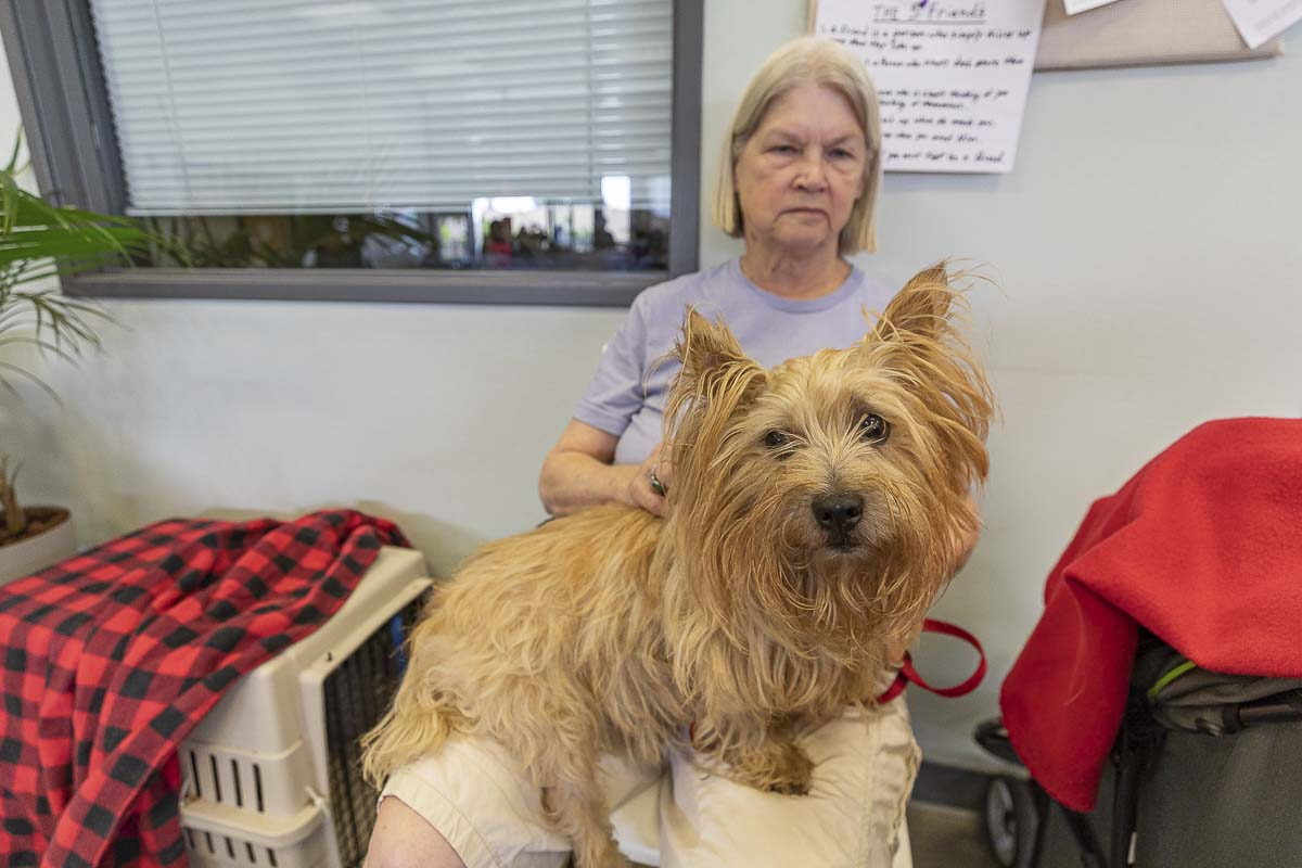 Deborah Brown with her dog inside the day center operated by Share out of the Vancouver Navigation Center. Photo by Mike Schultz