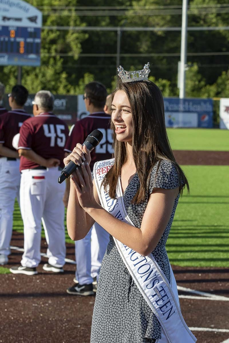 Payton May is shown here performing the national anthem at the Ridgefield Raptors' Opening Night Tuesday at the Ridgefield Outdoor Recreation Complex. Photo by Mike Schultz