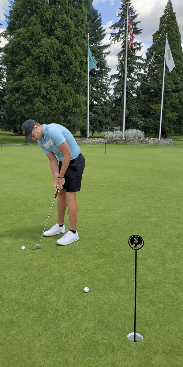 Spencer Tibbits got a few practice putts in Thursday at Royal Oaks. Instead of preparing for this week's Royal Oaks Invitational Tournament, he is leaving this weekend for California to play in the U.S. Open. Photo by Paul Valencia