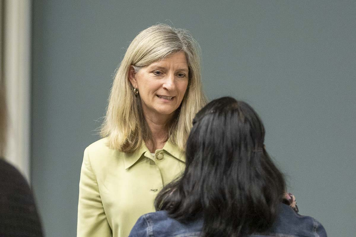 Representative Vicki Kraft (R-Vancouver) speaks with a voter following a town hall meeting at WSU Vancouver. Photo by Mike Schultz