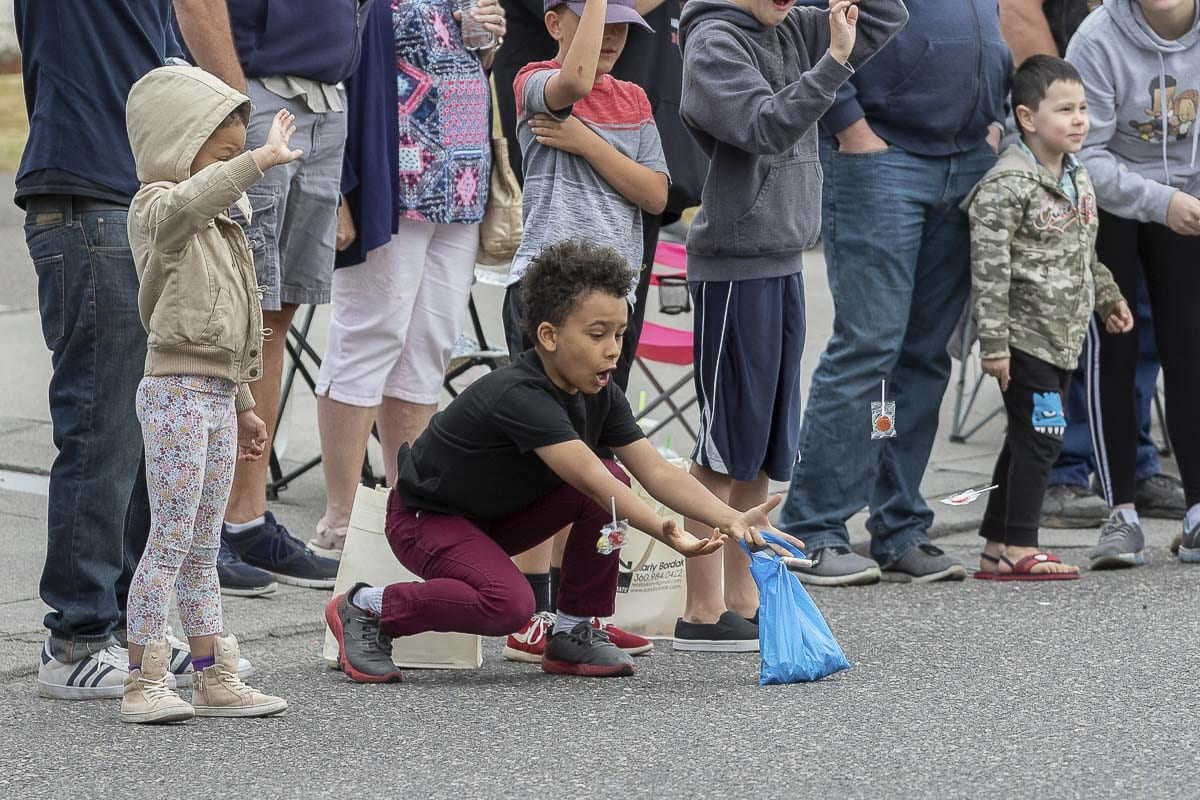 Hundreds of children hoping to satisfy their sweet tooth lined the streets for the Planters Days parade, which featured classic cars, military vehicles, logging trucks, and floats from various community organizations, churches, and charitable foundations. Photo by Mike Schultz