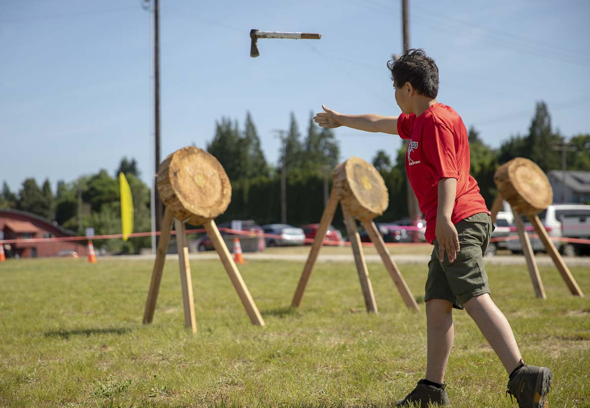 Ethan Dulay, of the local Boy Scouts troop, practices throwing a tomahawk at the scouts' throwing range during the Big Paddle. Photo by Jacob Granneman