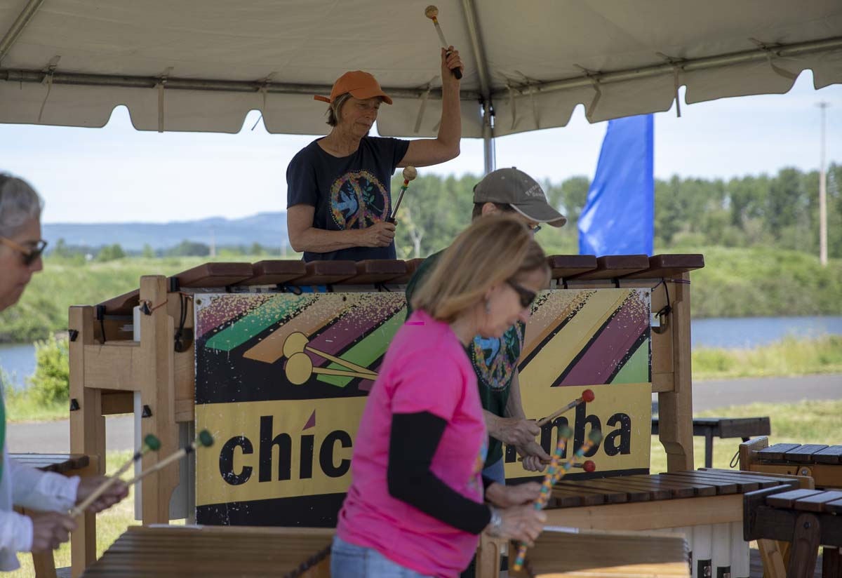 "Members of ""Chicamarimba"" play upbeat and joyful tunes on their variously sized marimbas during the on shore Big Paddle celebration. Photo by Jacob Granneman"