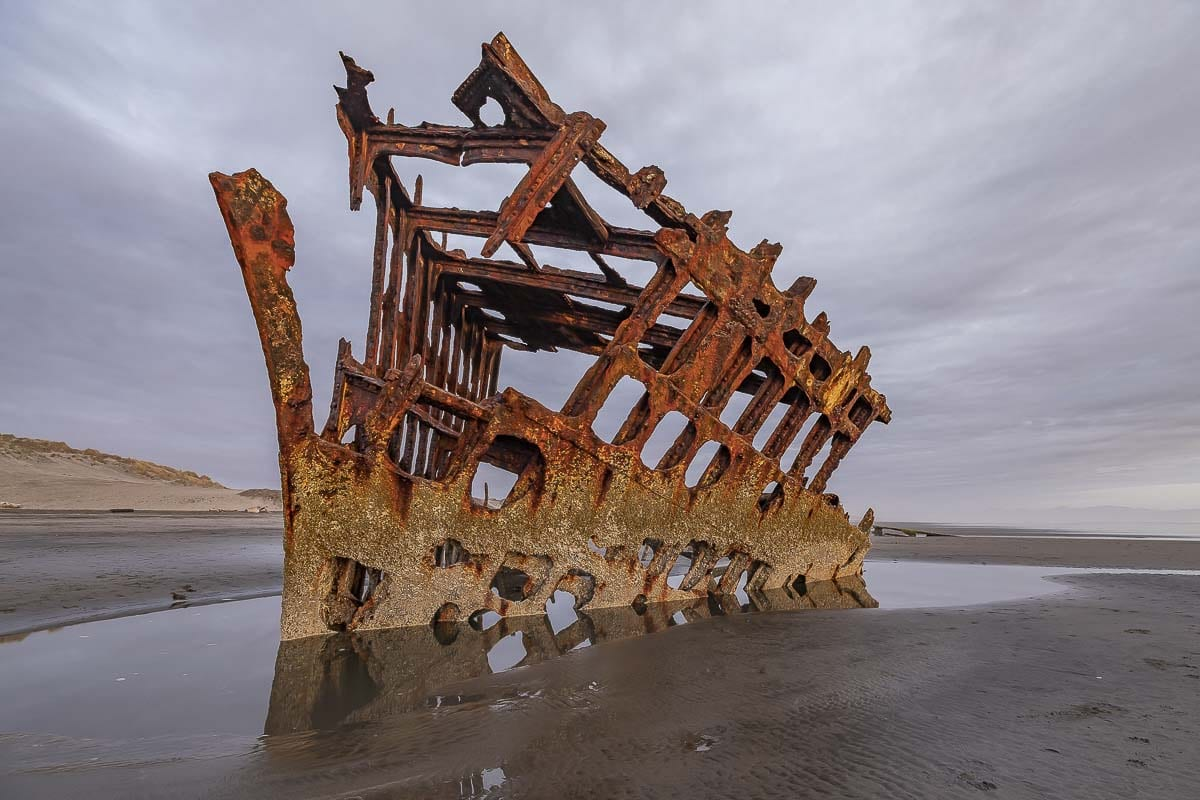 The Wreck of the Peter Iredale from 1906 inside Fort Stevens State Park. Photo by Mike Schultz