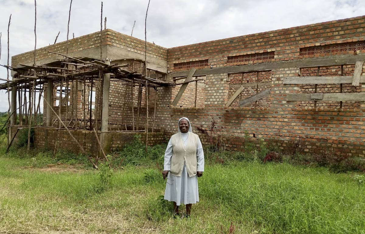Sister Elizabeth Namazzi, is shown here, standing outside the partially constructed education and medical center she founded in the Masaka region of Uganda. Photo courtesy of Sister Elizabeth Namazzi