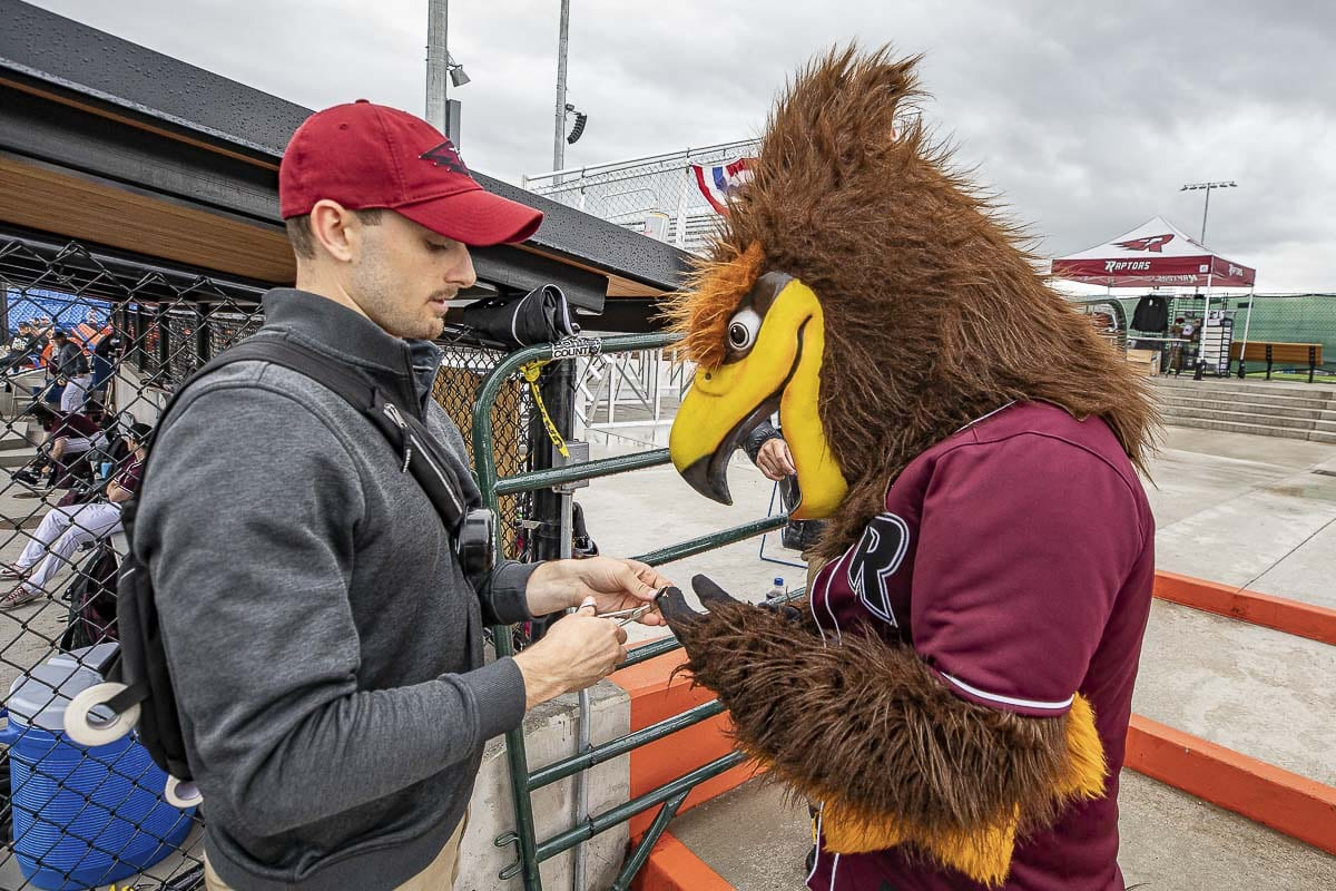 Mason Trezise does not limit his professional care to just baseball players. Rally the Raptor needed some attention earlier this week, and Trezise, the team's athletic trainer, was ready. Photo by Mike Schultz