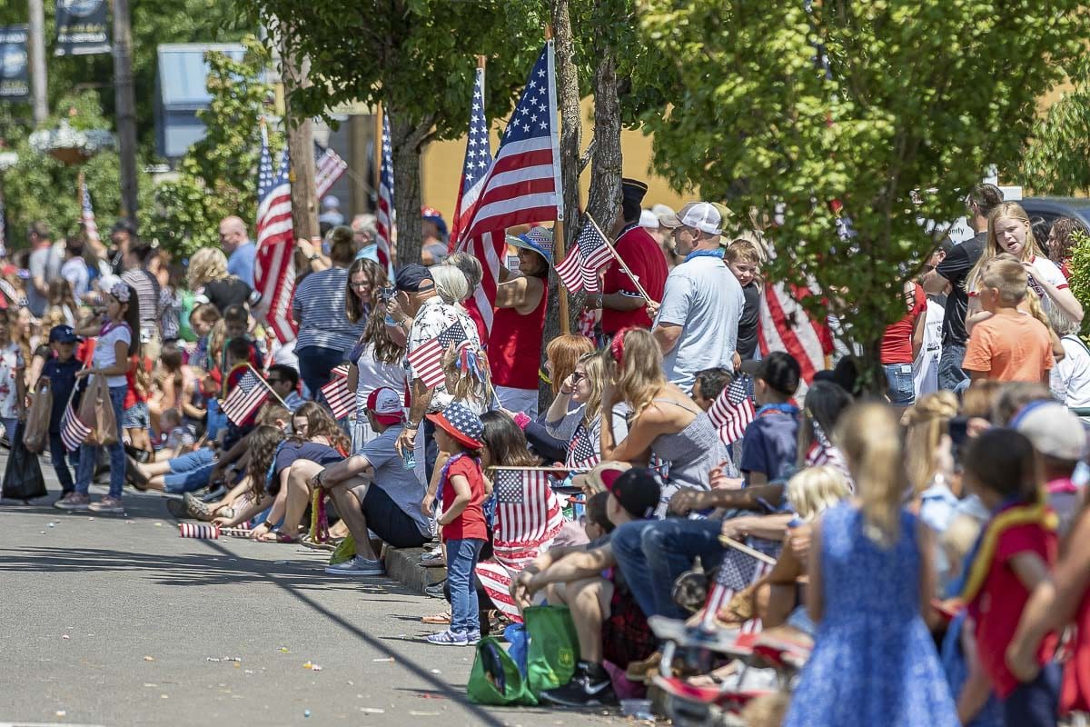 """Often described as """"Small town life at its best,"""" the Ridgefield Fourth of July Parade attracts thousands of spectators each year. Photo by Mike Schultz"""