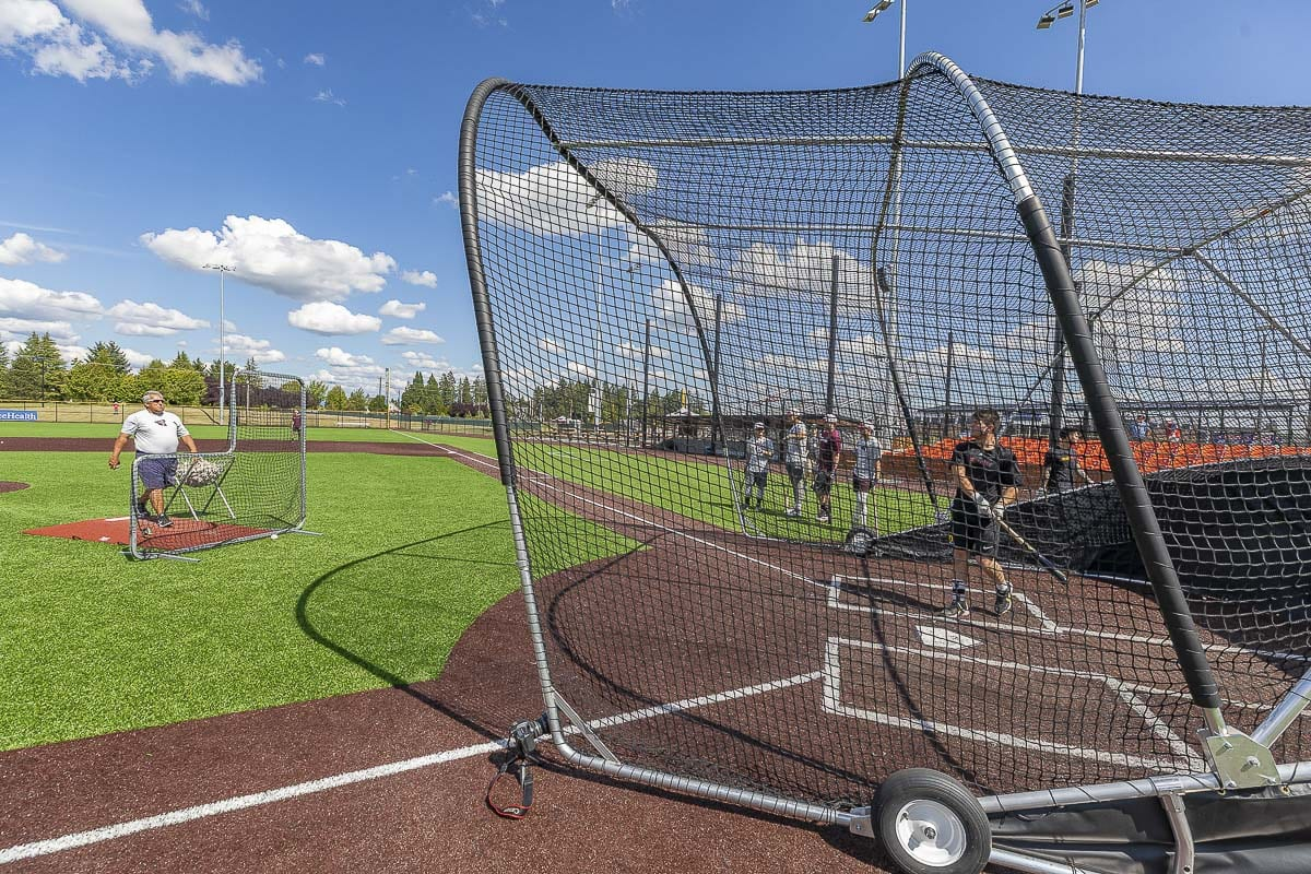 There is only about 40 to 45 feet from pitcher to home plate during batting practice. The L-screen gives the pitcher protection, provided he gets behind the net as soon as he releases the pitch. Photo by Mike Schultz