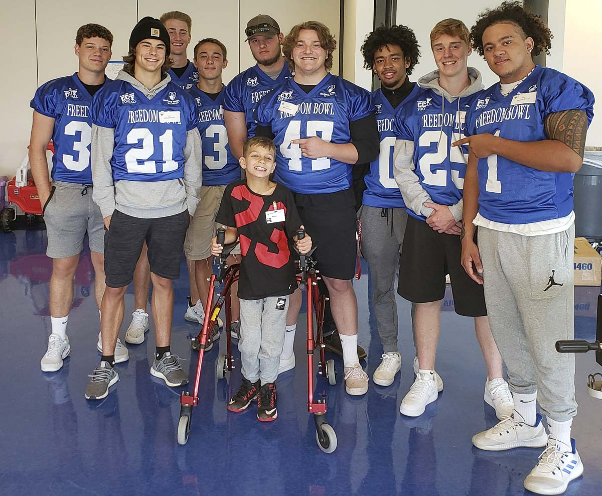 Rohen, an 8-year-old from Canby, Ore., was all smiles Thursday when he got to meet football players from the Freedom Bowl Classic. Photo by Paul Valencia