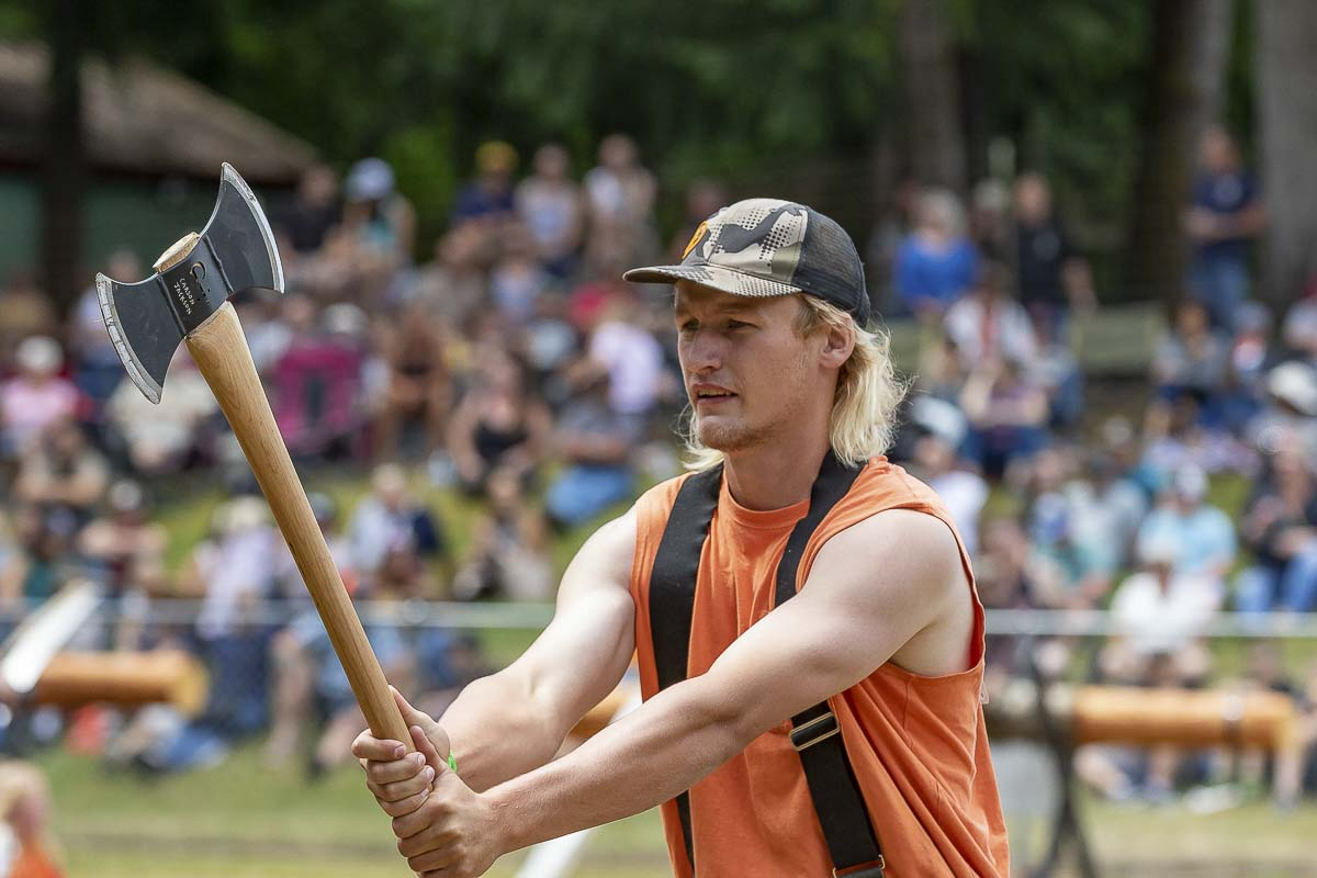 Amboy resident Travis Hafner competes in the axe throw event. Photo by Mike Schultz