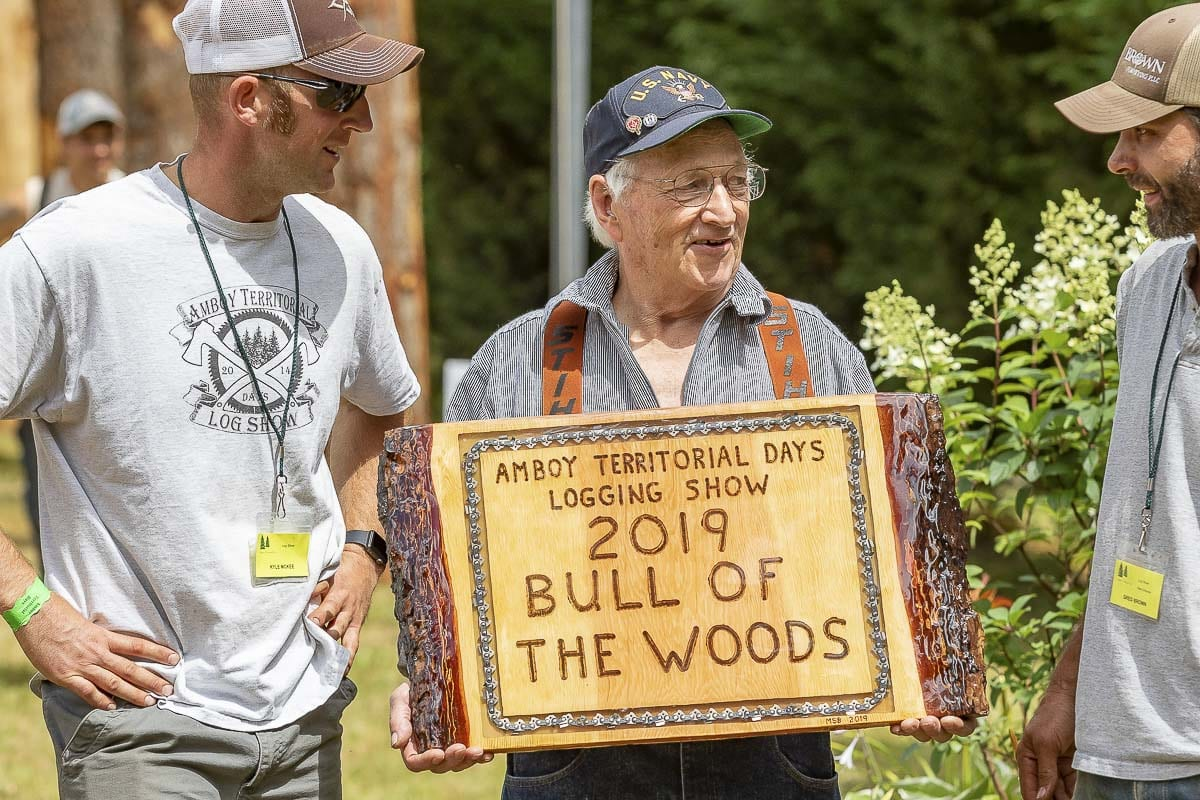 The 2019 Bull of the Woods award was presented to Navy Veteran and mechanic Jack Kelly, pictured center with Log Show organizers Kyle McKee (left) and Greg Brown (right). Photo by Mike Schultz