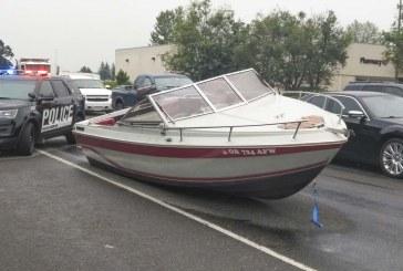 Boat slides off trailer at Battle Ground intersection