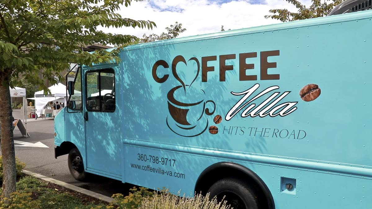 Coffee Villa Hits the Road uses a state-of-the-art food truck to bring organic coffee to events all over Clark County. It is seen here at the eastside Vancouver Farmers Market. Photo by Jacob Granneman