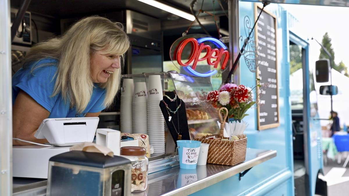 Linda Selivanow is seen here, talking with customers at her brand new coffee food truck, Coffee Villa Hits the Road. Photo by Jacob Granneman