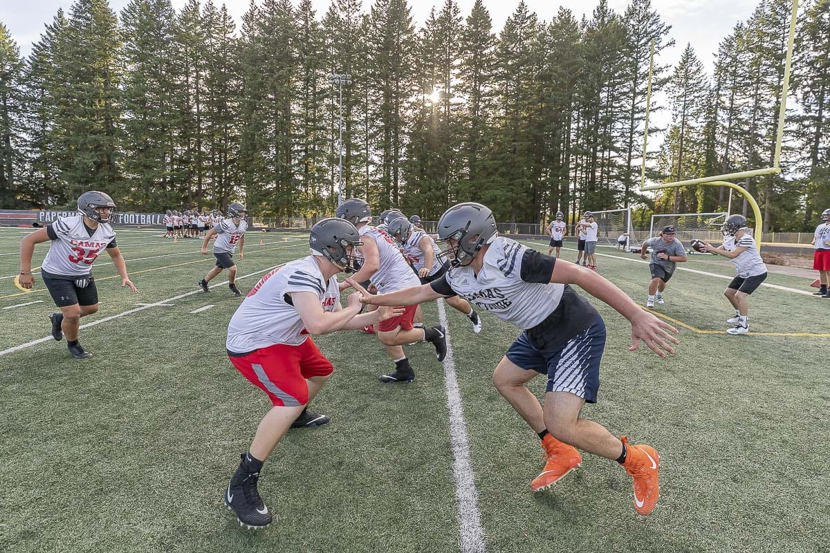 The Papermakers look cool, practicing in the shade. Camas, which has finished second in the 4A GSHL the past two seasons, is hoping to return to the top of the league this year. Photo by Mike Schultz