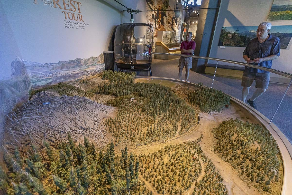 Inside the Forest Learning Center, an actual helicopter, shown here, serves as the cockpit for a virtual tour of the surrounding landscape. Photo by Mike Schultz