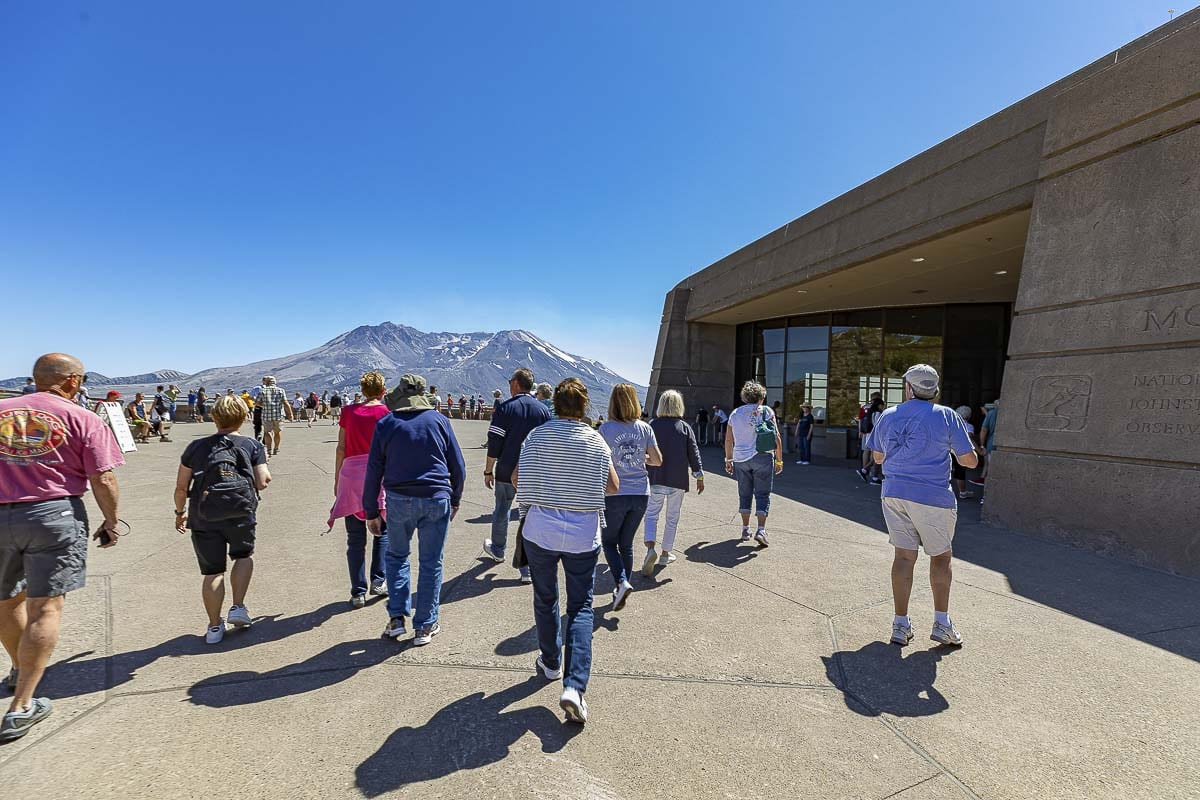 Shown here are people making their way to the main viewing platform outside Johnston Ridge Observatory on a clear day in July. Photo by Mike Schultz