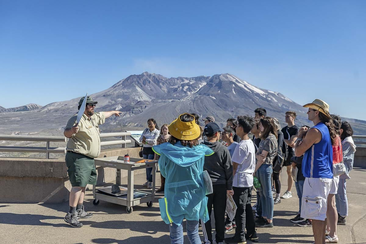 Icelandic Volcanologist and Ranger, Jorge Montalvo, conducts a presentation, shown here, atop Johnston Ridge Observatory's main outlook area. Photo by Mike Schultz