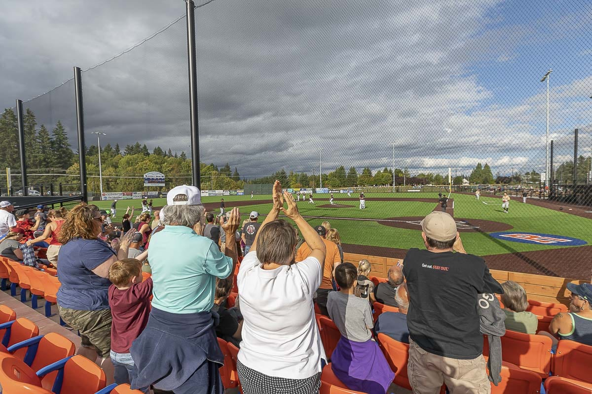 Ridgefield Raptors fans celebrate the final out of Sunday's game, which also was the final out of the inaugural season. Photo by Mike Schultz