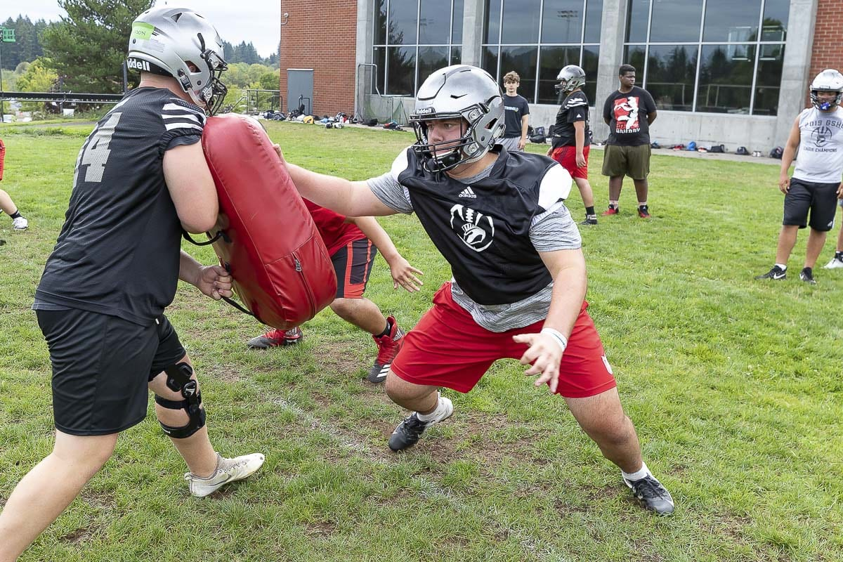Center Jack Grimsted (right, red shorts) has practiced snapping the football 500 times a day in an effort to perfect his craft as a key member of the Union offensive line. Photo by Mike Schultz