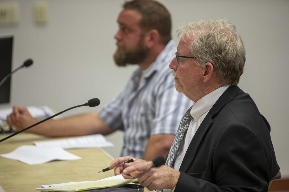 JL Storedahl and Sons' attorney William Lynn (front) and mine operator Bo Storedahl (back) are seen here presenting the appellant's argument before the county hearing examiner during the Aug. 22 Land Use Hearing. Photo by Jacob Granneman