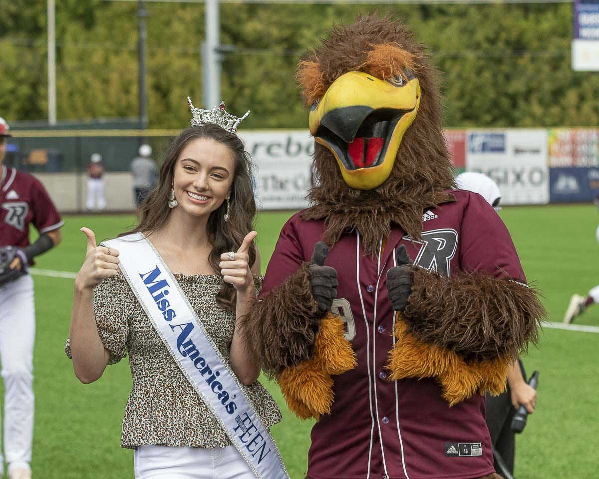 Vancouver's Payton May (left), the 2019 Miss America's Outstanding Teen, is shown here with Rally the Raptor at the season finale of the Ridgefield Raptors at the Ridgefield Outdoor Recreation Complex. Photo by Mike Schultz