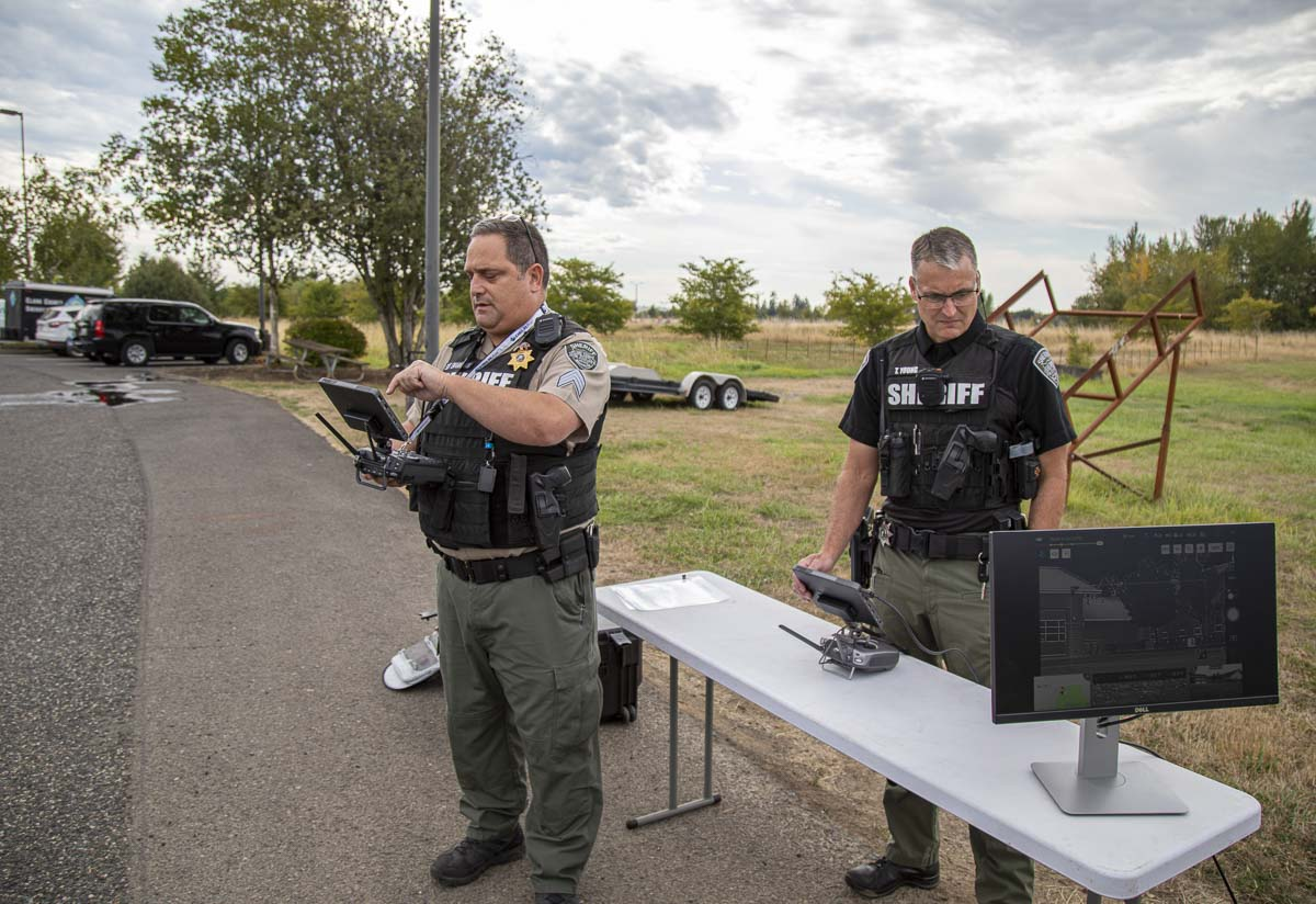 Sgt. Jason Granneman (left), and Det. Todd Young (right), pilot and operate the Matrice 210 UAS's dual cameras, respectively. Photo by Jacob Granneman