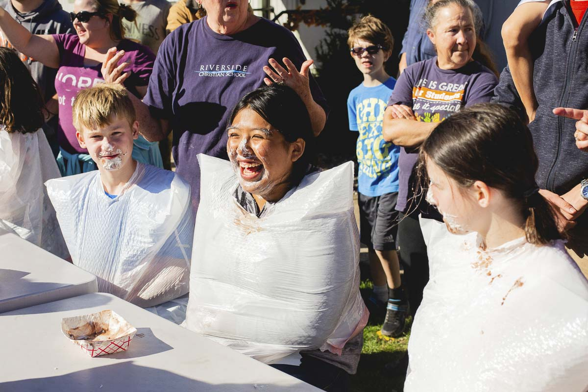 Several eating contests are part of the festival fun, with many harvest-time treats to try, including apple turnovers. Photo courtesy of Riverside Christian School