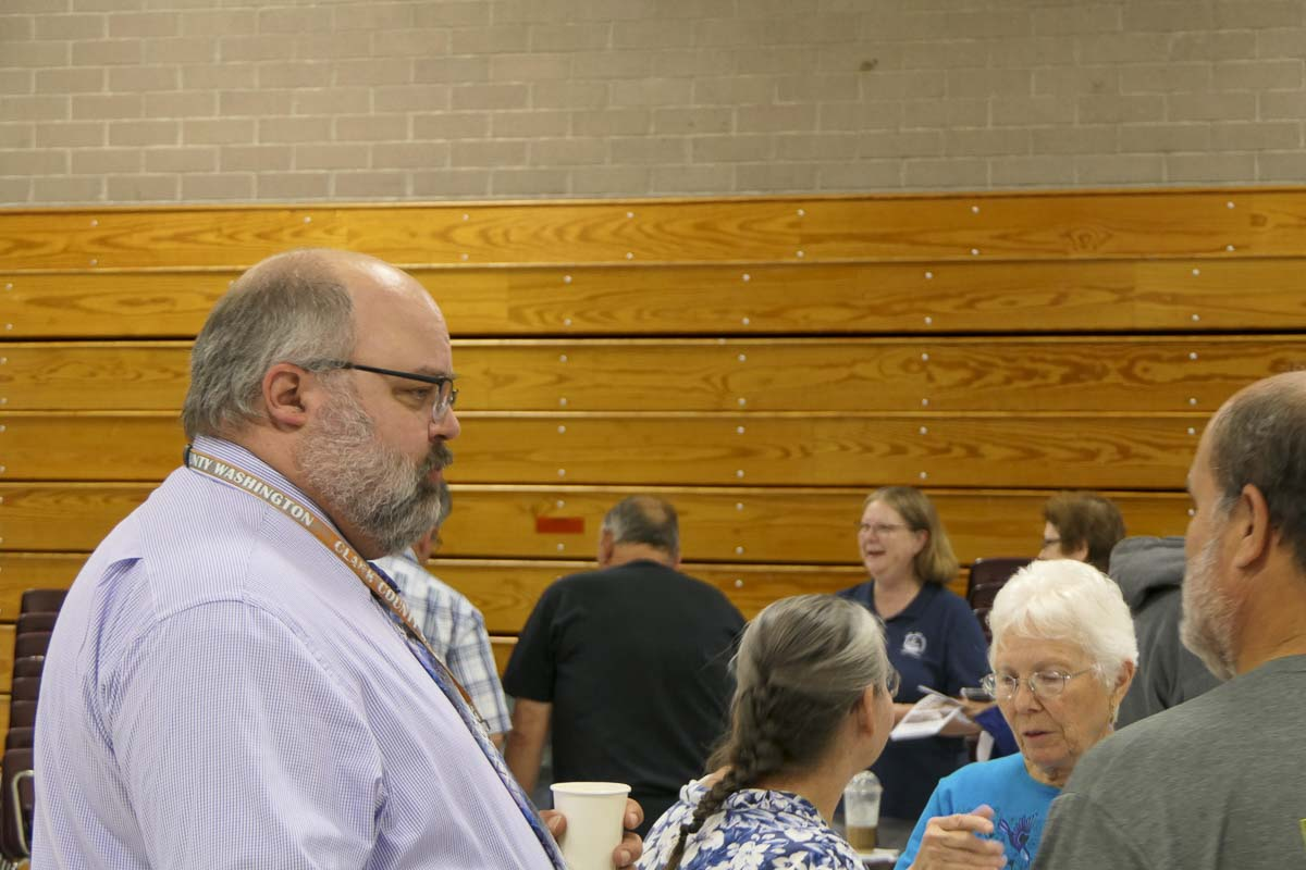 Clark County Transportation Division Manager Robert Klug speaks with residents during an open house on the I-5/179th area traffic improvement plan. Photo by Chris Brown