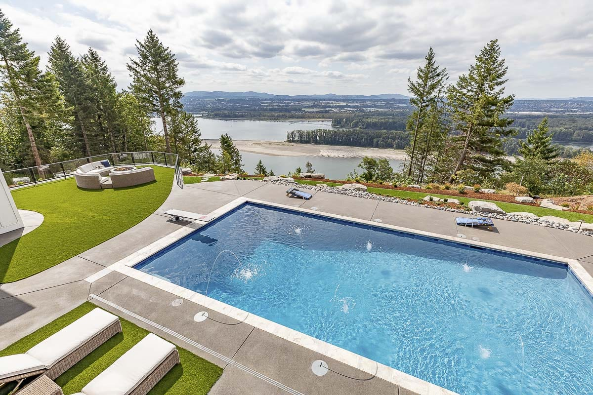 A pool, outdoor living space and a spectacular view on just some of the many eye-opening features of The Aurora. Photo by Mike Schultz