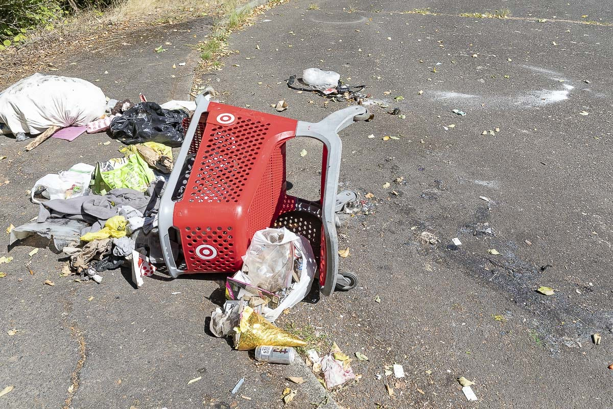 An overturned Target shopping cart and a pile of trash mark the west entrance to Arnold Park in Vancouver. Photo by Mike Schultz