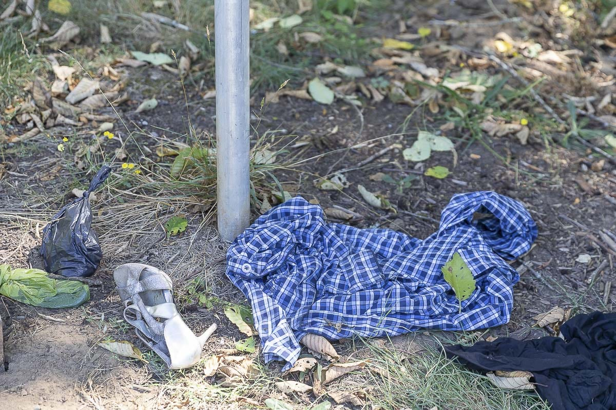 Discarded clothing and bags of waste are left at the west entrance to Arnold Park along the Burnt Bridge Creek Trail. Photo by Mike Schultz