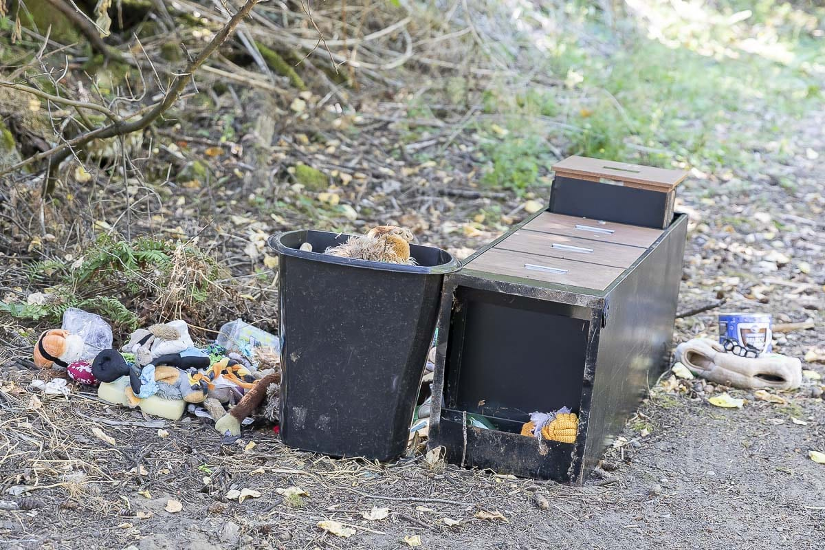 Children's toys, a file cabinet, and more are piled up at a former campsite off Burnt Bridge Creek Trail inside Arnold Park. Photo by Mike Schultz