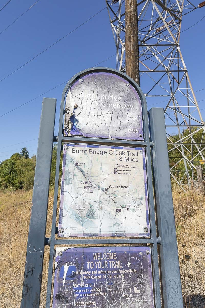 A sign along St. Johns Road marks the entrance to the Burnt Bridge Creek Trail through Arnold Park. Photo by Mike Schultz