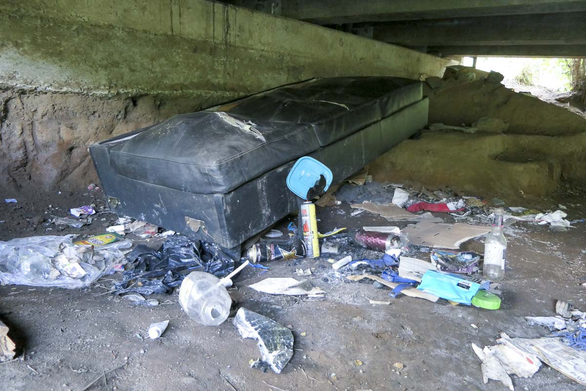 A homeless camp has been set up underneath a bridge along the Burnt Bridge Creek Trail in Arnold Park. Photo by Chris Brown