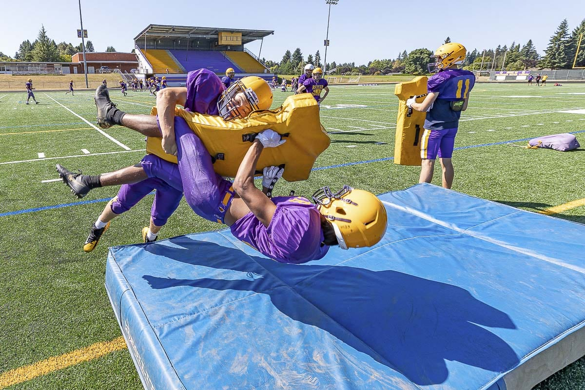The Columbia River Chieftains have some fun while learning proper tackling technique. They hope to have more fun this season, too. Photo by Mike Schultz